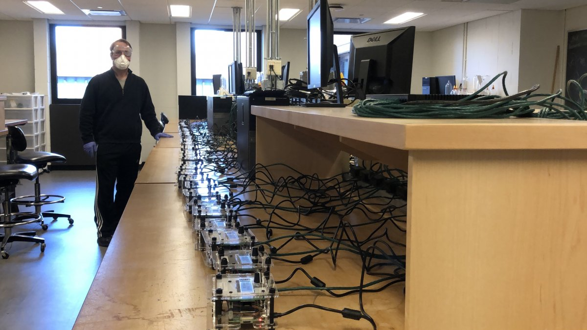 Professor Chris Tully performing the network tests with the first batch of patient box controllers.